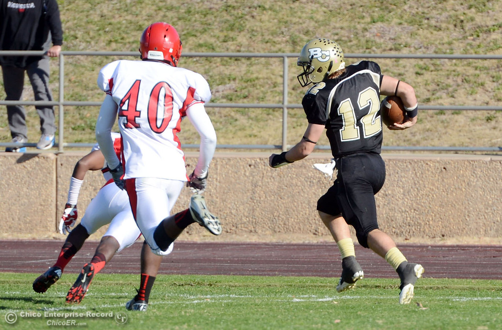 . Butte College\'s #12 Thomas Stuart runs for the first down against City College of San Francisco in the first quarter of their football game at Butte\'s Cowan Stadium Saturday, November 16, 2013 in Butte Valley, Calif.  (Jason Halley/Chico Enterprise-Record)