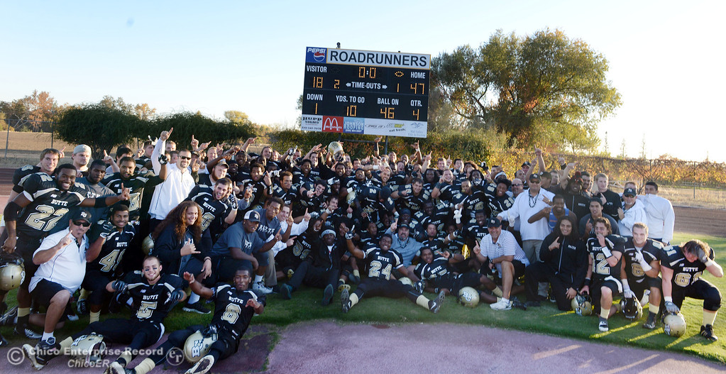 . Butte College celebrates their win against City College of San Francisco at the end of their football game at Butte\'s Cowan Stadium Saturday, November 16, 2013 in Butte Valley, Calif.  (Jason Halley/Chico Enterprise-Record)
