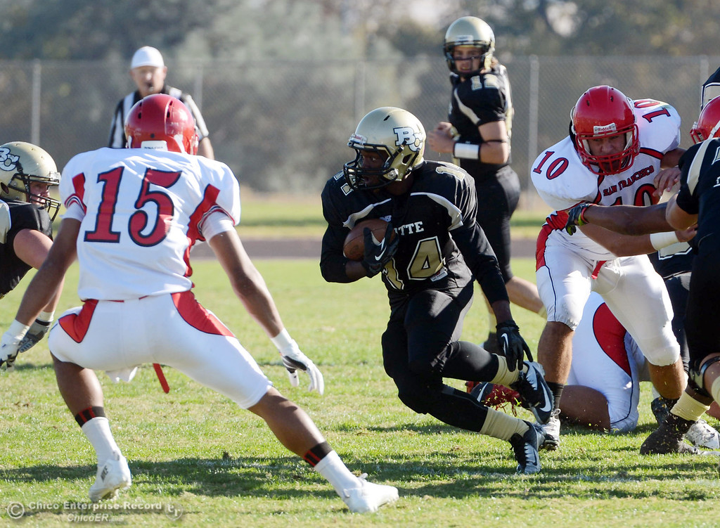 . Butte College\'s #14 Robert Frazier (center) rushes against City College of San Francisco in the first quarter of their football game at Butte\'s Cowan Stadium Saturday, November 16, 2013 in Butte Valley, Calif.  (Jason Halley/Chico Enterprise-Record)