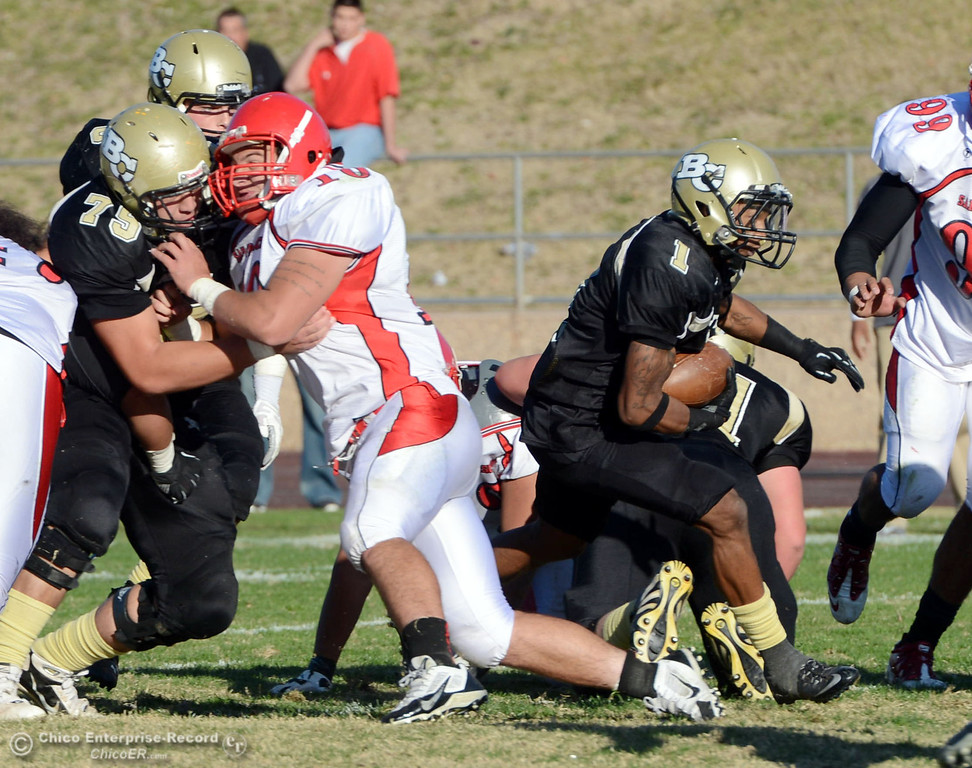 . Butte College\'s #1 Wes McCoy (right) rushes against City College of San Francisco in the third quarter of their football game at Butte\'s Cowan Stadium Saturday, November 16, 2013 in Butte Valley, Calif.  (Jason Halley/Chico Enterprise-Record)