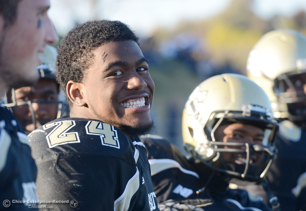 . Butte College\'s #24 Kendall Williams smiles against City College of San Francisco in the fourth quarter of their football game at Butte\'s Cowan Stadium Saturday, November 16, 2013 in Butte Valley, Calif.  (Jason Halley/Chico Enterprise-Record)
