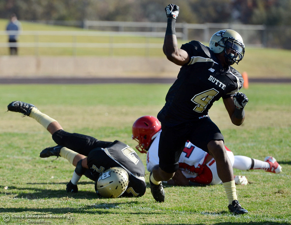 . Butte College\'s #4 Chris Edwards reacts to a tackle against City College of San Francisco in the first quarter of their football game at Butte\'s Cowan Stadium Saturday, November 16, 2013 in Butte Valley, Calif.  (Jason Halley/Chico Enterprise-Record)