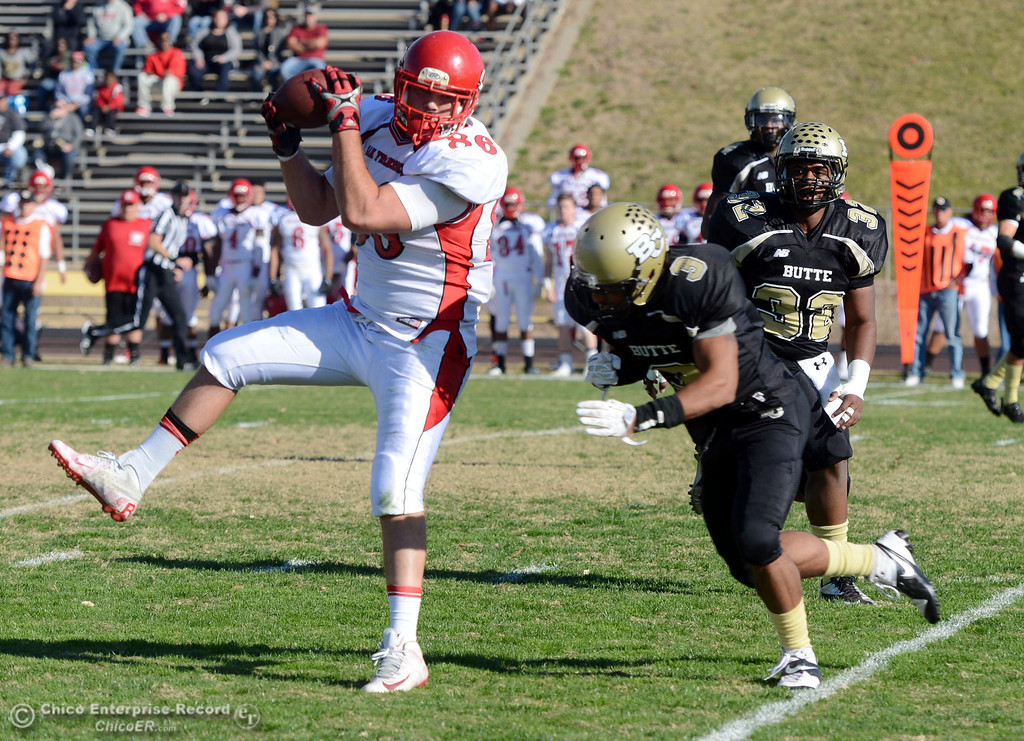 . City College of San Francisco\'s #86 Ryan Virgin (left) catches a pass against Butte College\'s #3 London Muse (center) and #32 Brian Anderson (right) in the first quarter of their football game at Butte\'s Cowan Stadium Saturday, November 16, 2013 in Butte Valley, Calif.  (Jason Halley/Chico Enterprise-Record)