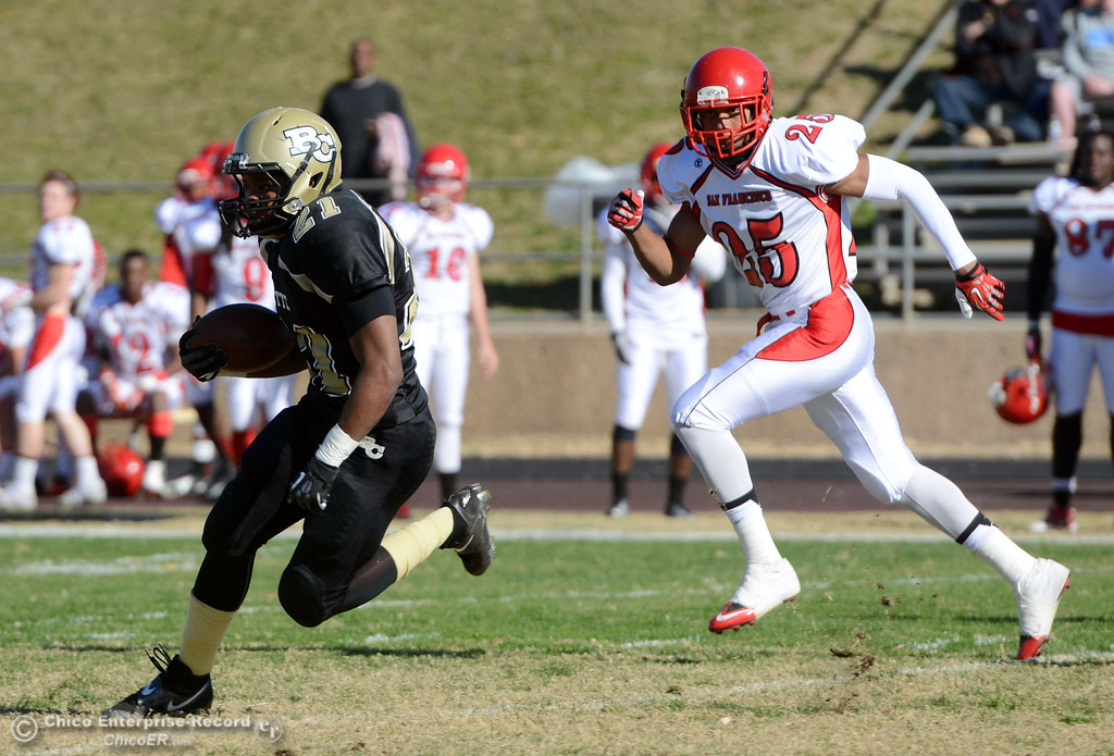 . Butte College\'s #21 Marvel Harris (left) rushes against City College of San Francisco\'s #25 Kenyatta McGhee-Jackson (right) in the first quarter of their football game at Butte\'s Cowan Stadium Saturday, November 16, 2013 in Butte Valley, Calif.  (Jason Halley/Chico Enterprise-Record)