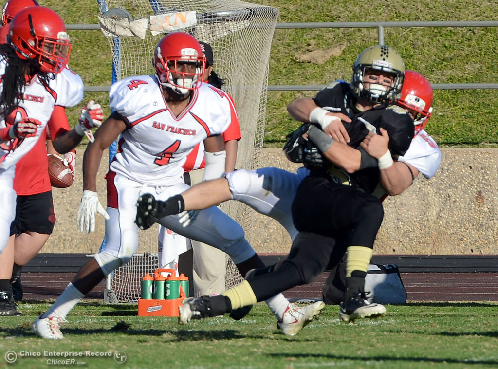 . Butte College\'s #5 David Brannon (right) is tackled against City College of San Francisco\'s #50 Kyle Martinez (left) in the third quarter of their football game at Butte\'s Cowan Stadium Saturday, November 16, 2013 in Butte Valley, Calif.  (Jason Halley/Chico Enterprise-Record)