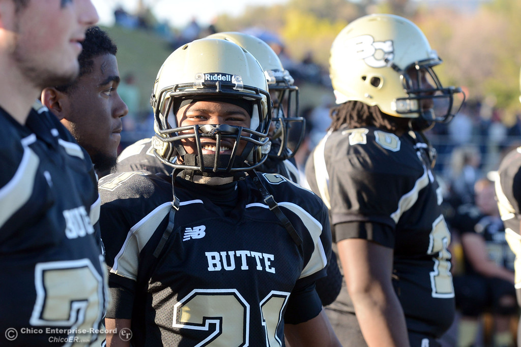 . Butte College\'s #21 Marvel Harris smiles against City College of San Francisco in the fourth quarter of their football game at Butte\'s Cowan Stadium Saturday, November 16, 2013 in Butte Valley, Calif.  (Jason Halley/Chico Enterprise-Record)