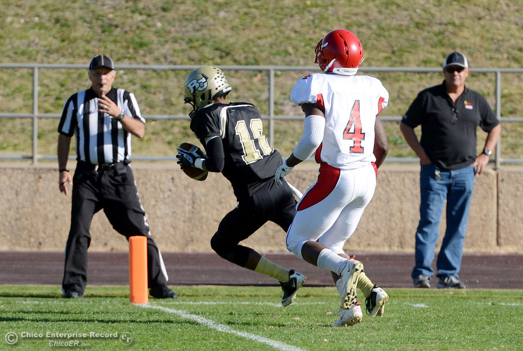 . Butte College\'s #10 CJ Grice (left) scores a touchdown against City College of San Francisco\'s #4 Maurice Cannon (right) in the first quarter of their football game at Butte\'s Cowan Stadium Saturday, November 16, 2013 in Butte Valley, Calif.  (Jason Halley/Chico Enterprise-Record)