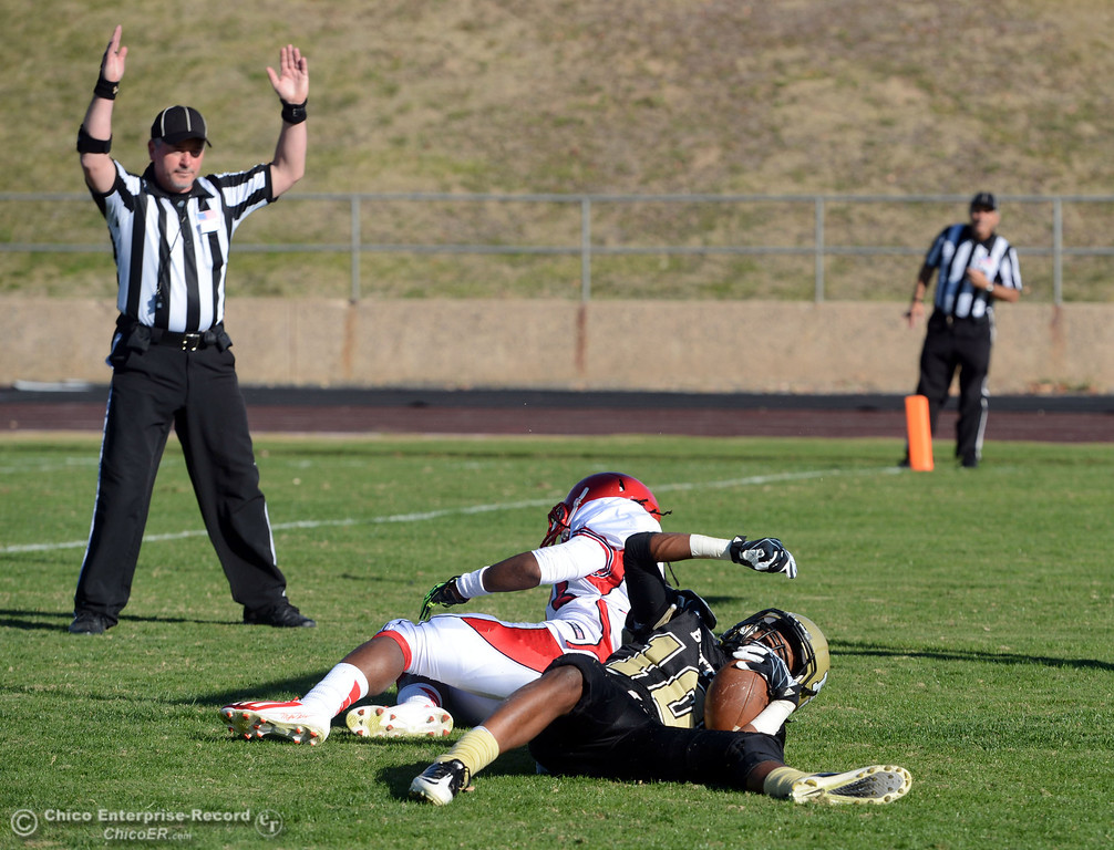 . Butte College\'s #10 CJ Grice (right) scores a touchdown against City College of San Francisco\'s #23 Myles Holmes (left) in the second quarter of their football game at Butte\'s Cowan Stadium Saturday, November 16, 2013 in Butte Valley, Calif.  (Jason Halley/Chico Enterprise-Record)