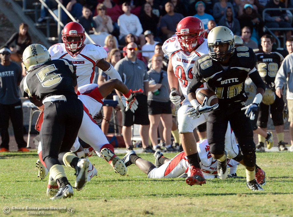 . Butte College\'s #10 CJ Grice (right) rushes against City College of San Francisco in the third quarter of their football game at Butte\'s Cowan Stadium Saturday, November 16, 2013 in Butte Valley, Calif.  (Jason Halley/Chico Enterprise-Record)