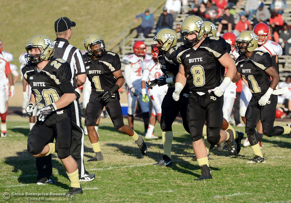 . Butte College\'s #20 Armand Bokitch (left) and #8 Bo Brummel (right) come off the field against City College of San Francisco in the fourth quarter of their football game at Butte\'s Cowan Stadium Saturday, November 16, 2013 in Butte Valley, Calif.  (Jason Halley/Chico Enterprise-Record)