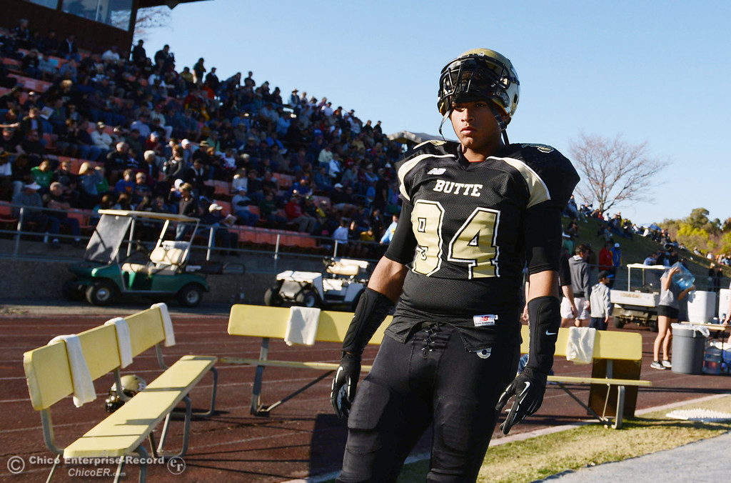 . Butte College\'s #94 Shannon Dinsdale on the sidelines against City College of San Francisco in the third quarter of their football game at Butte\'s Cowan Stadium Saturday, November 16, 2013 in Butte Valley, Calif.  (Jason Halley/Chico Enterprise-Record)