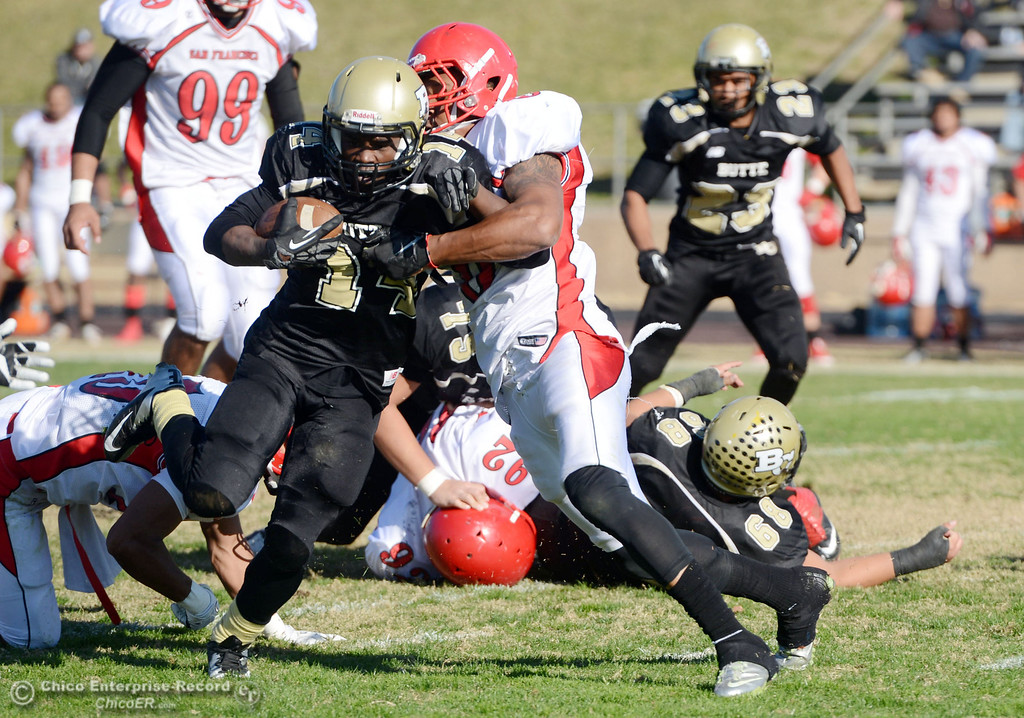 . Butte College\'s #14 Robert Frazier (left) is tackled against City College of San Francisco\'s #6 James Hickman (right) in the second quarter of their football game at Butte\'s Cowan Stadium Saturday, November 16, 2013 in Butte Valley, Calif.  (Jason Halley/Chico Enterprise-Record)