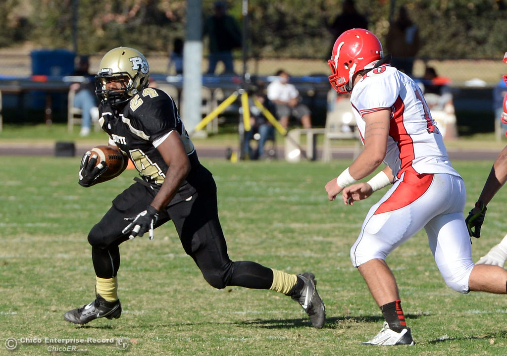 . Butte College\'s #24 Kendall Williams (left) rushes against City College of San Francisco in the second quarter of their football game at Butte\'s Cowan Stadium Saturday, November 16, 2013 in Butte Valley, Calif.  (Jason Halley/Chico Enterprise-Record)