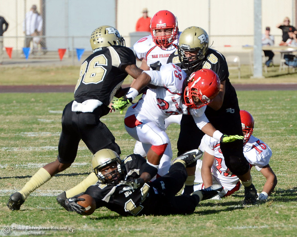 . Butte College\'s #14 Robert Frazier (bottom) is tackled against City College of San Francisco in the second quarter of their football game at Butte\'s Cowan Stadium Saturday, November 16, 2013 in Butte Valley, Calif.  (Jason Halley/Chico Enterprise-Record)