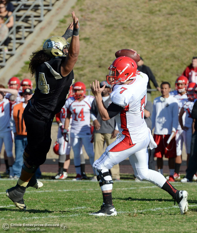 . Butte College\'s #74 Christopher Siliga (left) pressures against City College of San Francisco\'s #7 Turner Baty (right) in the second quarter of their football game at Butte\'s Cowan Stadium Saturday, November 16, 2013 in Butte Valley, Calif.  (Jason Halley/Chico Enterprise-Record)