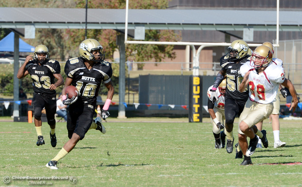 . Butte College\'s #10 CJ Grice carries a kick return for a touchdown against De Anza College in the second quarter of their football game at Butte\'s Cowan Stadium Saturday, October 26, 2013 in Oroville, Calif.  (Jason Halley/Chico Enterprise-Record)