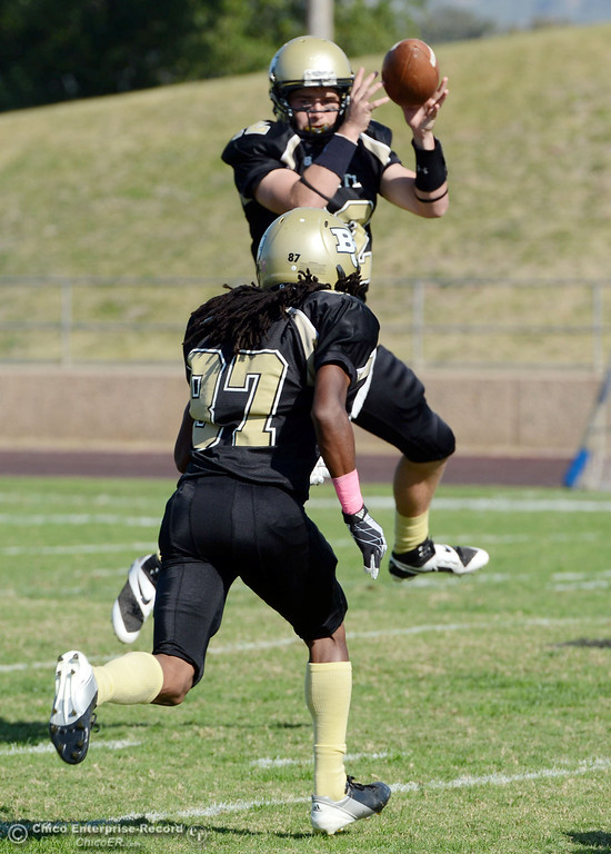 . Butte College\'s #12 Thomas Stuart (top) receives the snap near #87 Timazray Shepherd (bottom) against De Anza College in the second quarter of their football game at Butte\'s Cowan Stadium Saturday, October 26, 2013 in Oroville, Calif.  (Jason Halley/Chico Enterprise-Record)