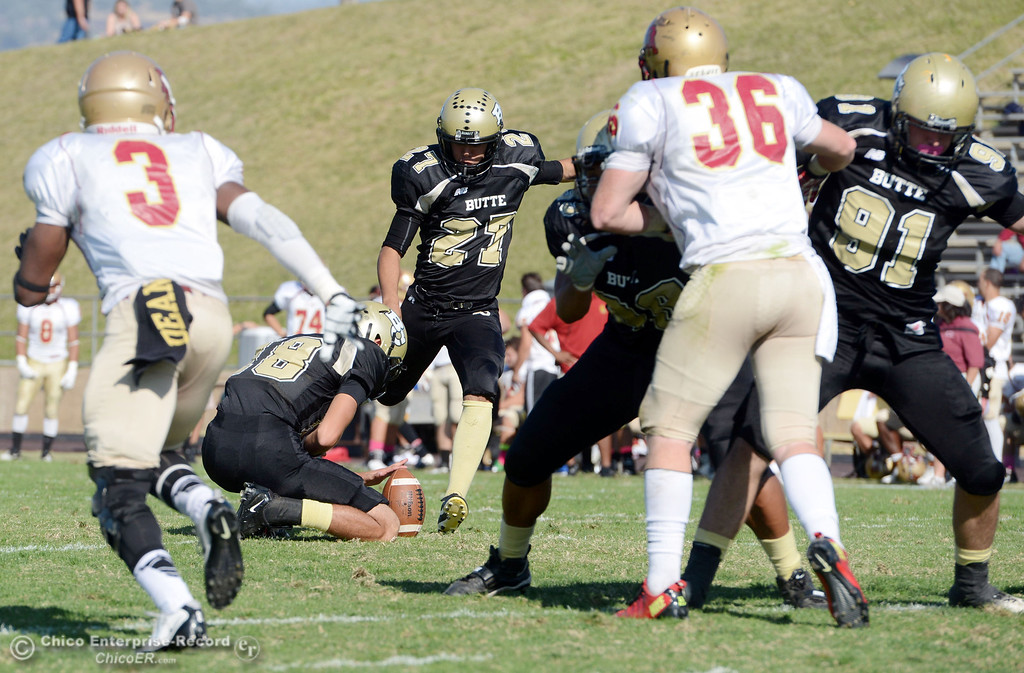 . Butte College\'s #27 Rigoberto Sanchez kicks the extra point against De Anza College in the second quarter of their football game at Butte\'s Cowan Stadium Saturday, October 26, 2013 in Oroville, Calif.  (Jason Halley/Chico Enterprise-Record)