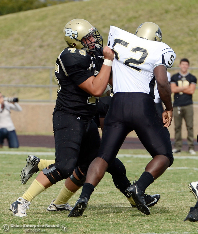 . Butte College\'s #75 Jacob Vazquez (left) pushes against Delta College\'s #52 Timothy McMihelk (right) in the third quarter of their football game at Butte\'s Cowan Stadium Saturday, September 28, 2013, in Oroville, Calif.  (Jason Halley/Chico Enterprise-Record)