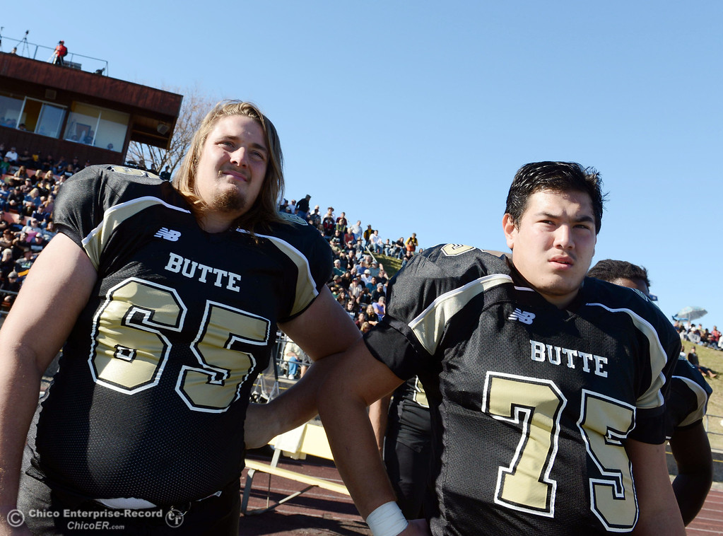 . Butte College\'s #65 Tyler Anglin (left) and #75 Jacob Vazquez (right) look on against Fresno City College in the second quarter of their football game at Butte\'s Cowan Stadium Saturday, November 30, 2013 in Butte Valley, Calif.  (Jason Halley/Chico Enterprise-Record)