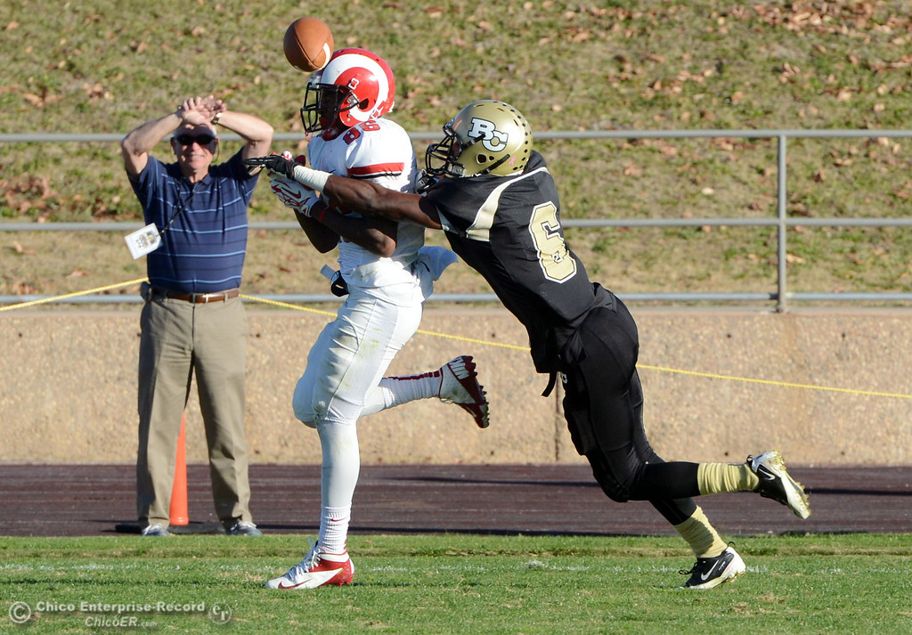 . Butte College\'s #6 Denzel Conyers (right) breaks up a pass in the end zone against Fresno City College\'s #86 Kevin Beckwith (left) in the fourth quarter of their football game at Butte\'s Cowan Stadium Saturday, November 30, 2013 in Butte Valley, Calif.  (Jason Halley/Chico Enterprise-Record)