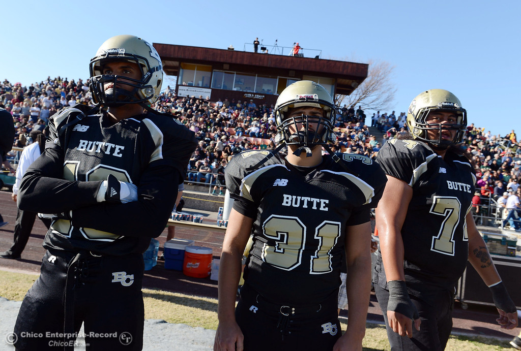 . Butte Colleges\' #10 CJ Grice, #31 Ted Staiger, and #74 Christopher Siliga (left to right) look on against Fresno City College in the second quarter of their football game at Butte\'s Cowan Stadium Saturday, November 30, 2013 in Butte Valley, Calif.  (Jason Halley/Chico Enterprise-Record)