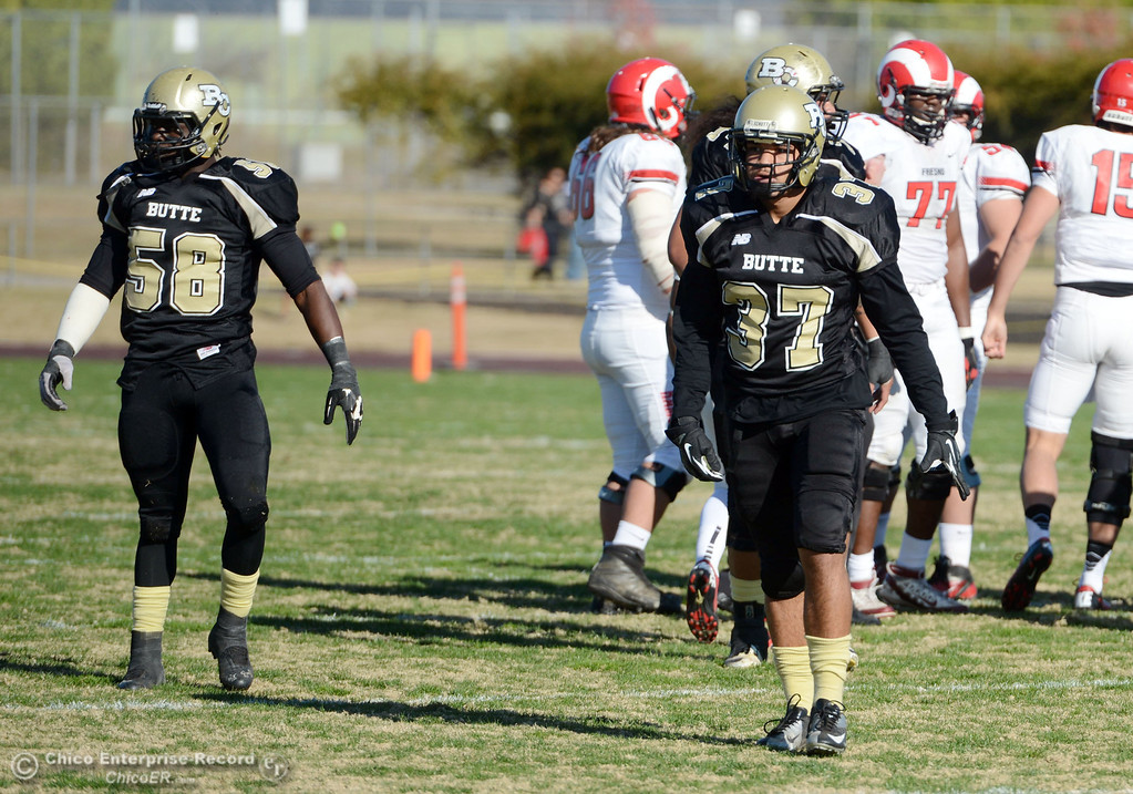 . Butte College\'s #58 Sie Doe Jr. and #37 Demetre Lopez (right) looks on against Fresno City College in the first quarter of their football game at Butte\'s Cowan Stadium Saturday, November 30, 2013 in Butte Valley, Calif.  (Jason Halley/Chico Enterprise-Record)