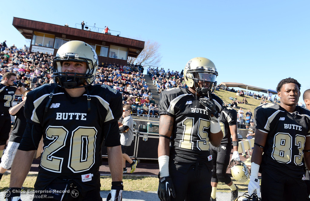 . Butte College\'s #20 Armand Bokitch, #15 Jalen Amis, and #83 Terez Cowan (left to right) look on against Fresno City College in the second quarter of their football game at Butte\'s Cowan Stadium Saturday, November 30, 2013 in Butte Valley, Calif.  (Jason Halley/Chico Enterprise-Record)