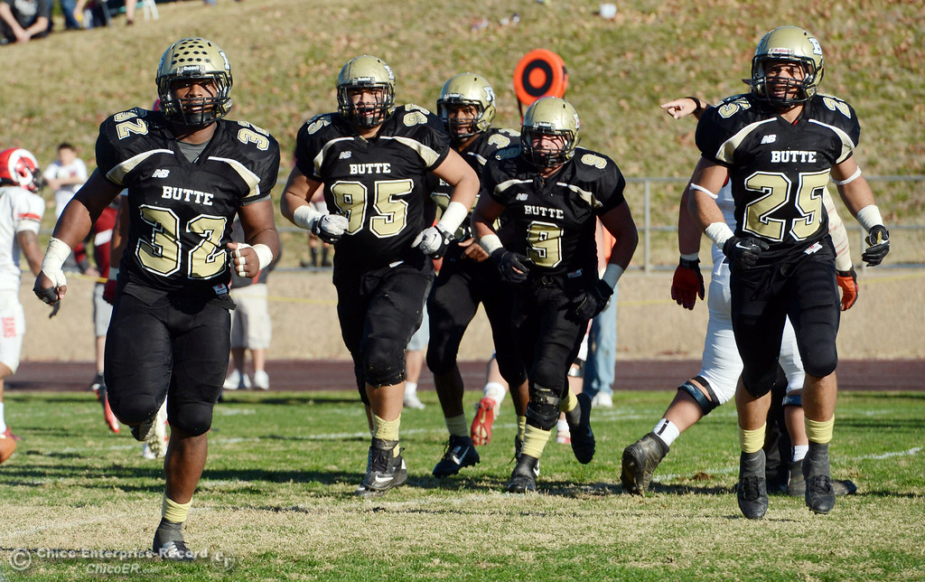 . Butte College\'s #32 Brian Anderson, #95 Mark Rosenquist, #33 Jariah Booker, #9 Tyler Adair and #25 De\'Aundray Gooden (left to right) against Fresno City College in the third quarter of their football game at Butte\'s Cowan Stadium Saturday, November 30, 2013 in Butte Valley, Calif.  (Jason Halley/Chico Enterprise-Record)