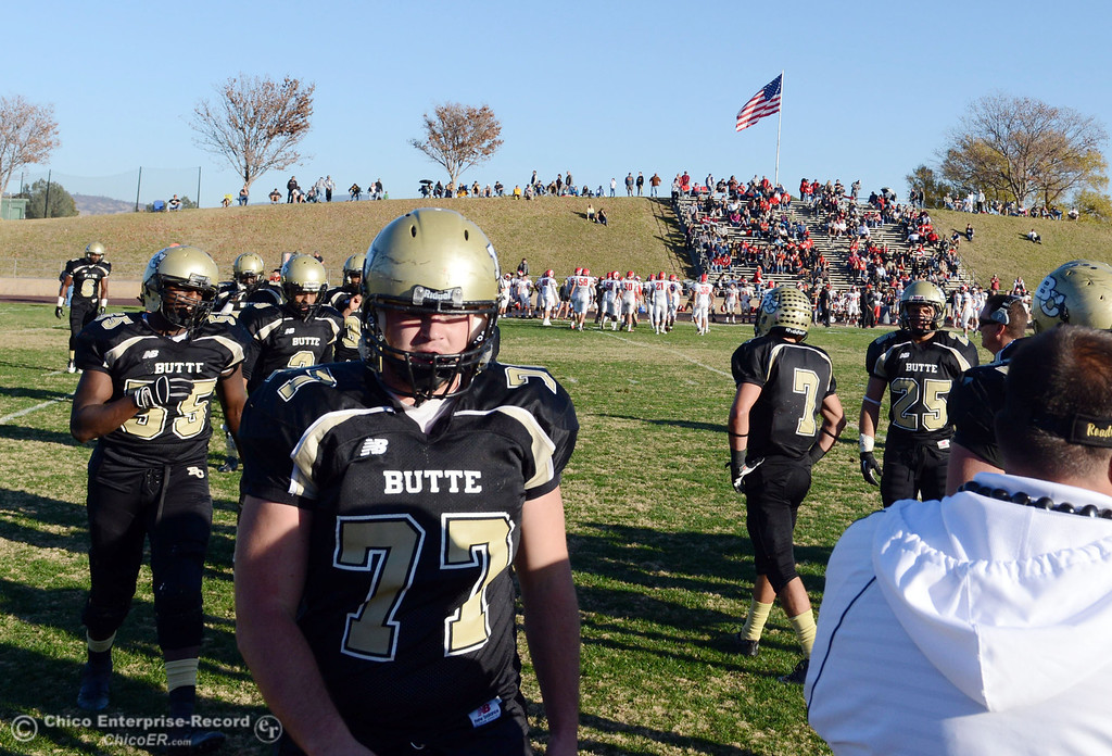 . Butte College\'s #77 Scott Batchelder comes off the field against Fresno City College in the fourth quarter of their football game at Butte\'s Cowan Stadium Saturday, November 30, 2013 in Butte Valley, Calif.  (Jason Halley/Chico Enterprise-Record)