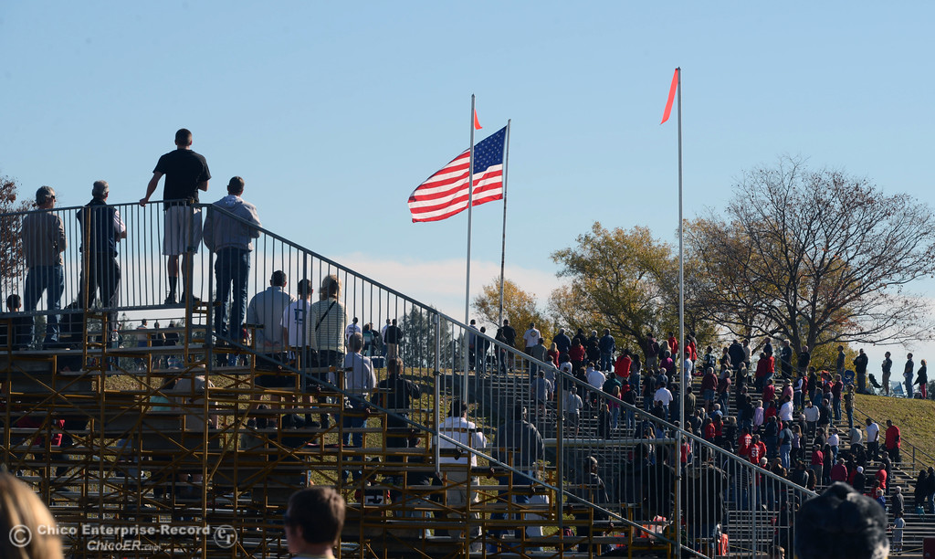 . The crowd stands for the National Anthem as Butte College faced Fresno City College in the first quarter of their football game at Butte\'s Cowan Stadium Saturday, November 30, 2013 in Butte Valley, Calif.  (Jason Halley/Chico Enterprise-Record)