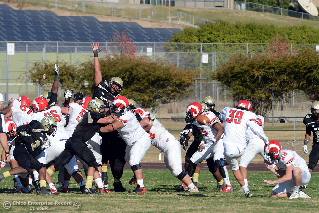 . Butte College attempt to block the field goal attempt against Fresno City College in the second quarter of their football game at Butte\'s Cowan Stadium Saturday, November 30, 2013 in Butte Valley, Calif.  (Jason Halley/Chico Enterprise-Record)