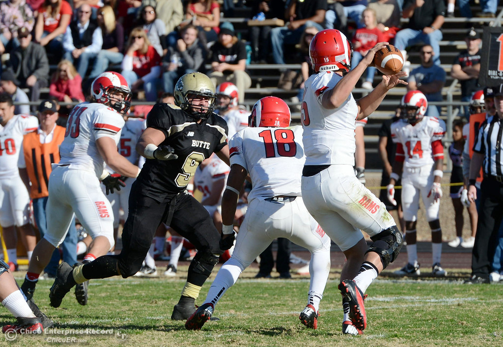 . Butte College\'s #9 Tyler Adair (left) defends against Fresno City College\'s #18 Micah Ledezma (center) on a pass by #15 Marcus Montero (right) in the second quarter of their football game at Butte\'s Cowan Stadium Saturday, November 30, 2013 in Butte Valley, Calif.  (Jason Halley/Chico Enterprise-Record)