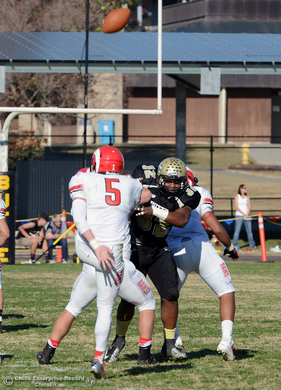 . Butte Colleges\' #32 Brian Anderson (right) defends against Fresno City College\'s #5 Brayden Sanchez (left) in the second quarter of their football game at Butte\'s Cowan Stadium Saturday, November 30, 2013 in Butte Valley, Calif.  (Jason Halley/Chico Enterprise-Record)