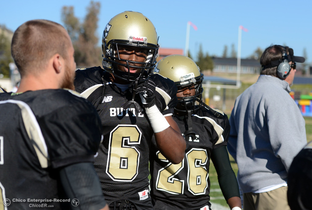 . Butte College\'s #6 Denzel Conyers (left) and #26 John Beckerleg (right) look on against Fresno City College in the first quarter of their football game at Butte\'s Cowan Stadium Saturday, November 30, 2013 in Butte Valley, Calif.  (Jason Halley/Chico Enterprise-Record)