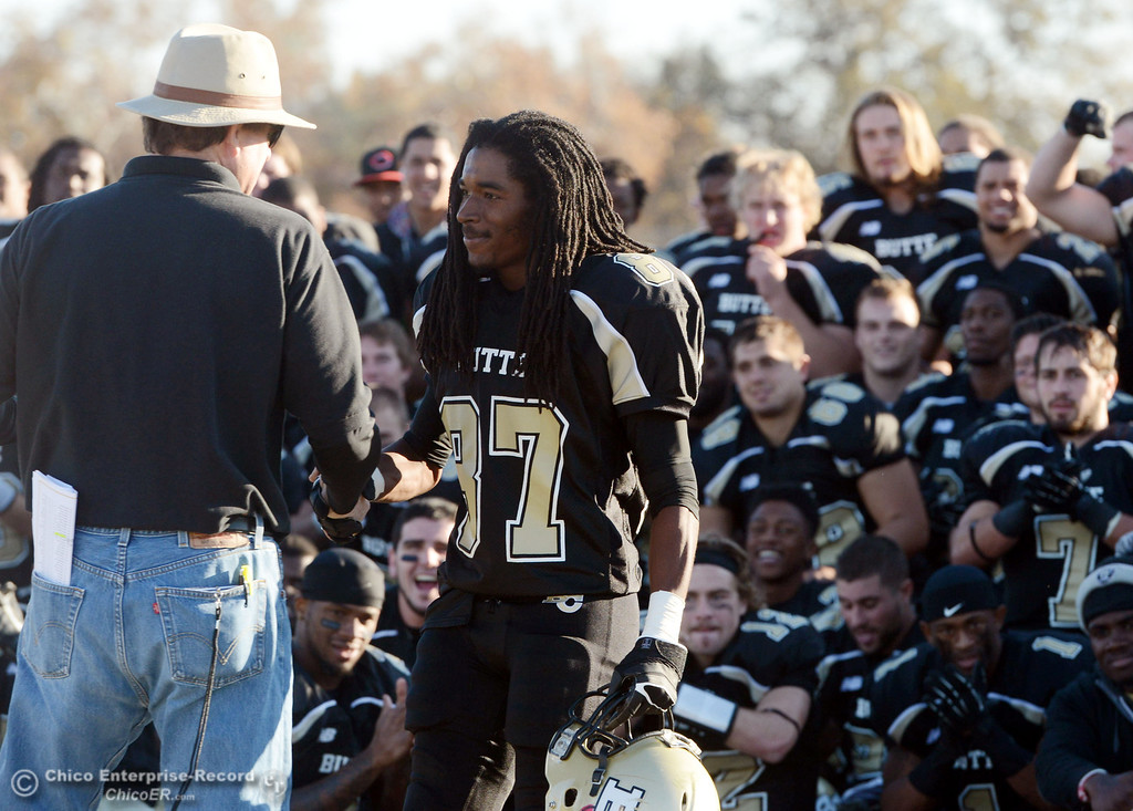 . Butte College\'s #87 Timazray Shepherd accepts the Nor Cal Offensive Player of the Game award against Fresno City College at the end of their football game at Butte\'s Cowan Stadium Saturday, November 30, 2013 in Butte Valley, Calif.  (Jason Halley/Chico Enterprise-Record)