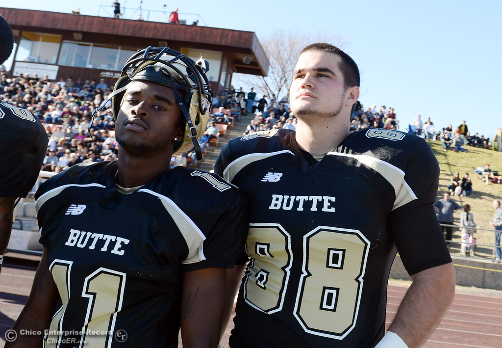 . Butte College\'s #11 Caleb McCullough (left) and #88 Ralph Raetz (right) look on against Fresno City College in the second quarter of their football game at Butte\'s Cowan Stadium Saturday, November 30, 2013 in Butte Valley, Calif.  (Jason Halley/Chico Enterprise-Record)