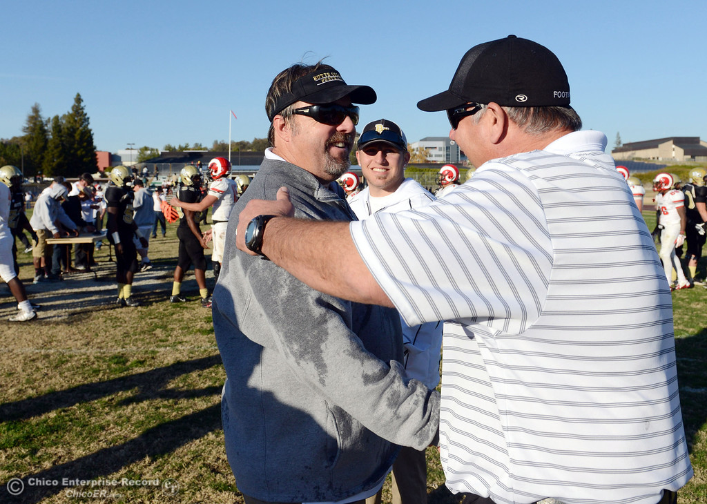 . Butte College coaches Jeff Jordan (left) and Willie Thomas (right) embrace to celebrate their win against Fresno City College at the end of their football game at Butte\'s Cowan Stadium Saturday, November 30, 2013 in Butte Valley, Calif.  (Jason Halley/Chico Enterprise-Record)