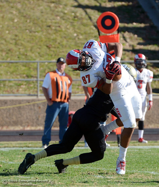 . Butte College\'s #4 Chris Edwards (left) lays a hit against Fresno City College\'s #87 Calvin Snowden (right) in the second quarter of their football game at Butte\'s Cowan Stadium Saturday, November 30, 2013 in Butte Valley, Calif.  (Jason Halley/Chico Enterprise-Record)