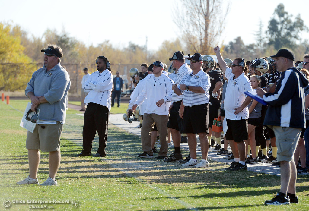 . Butte College coaching staff look on against Fresno City College in the fourth quarter of their football game at Butte\'s Cowan Stadium Saturday, November 30, 2013 in Butte Valley, Calif.  (Jason Halley/Chico Enterprise-Record)