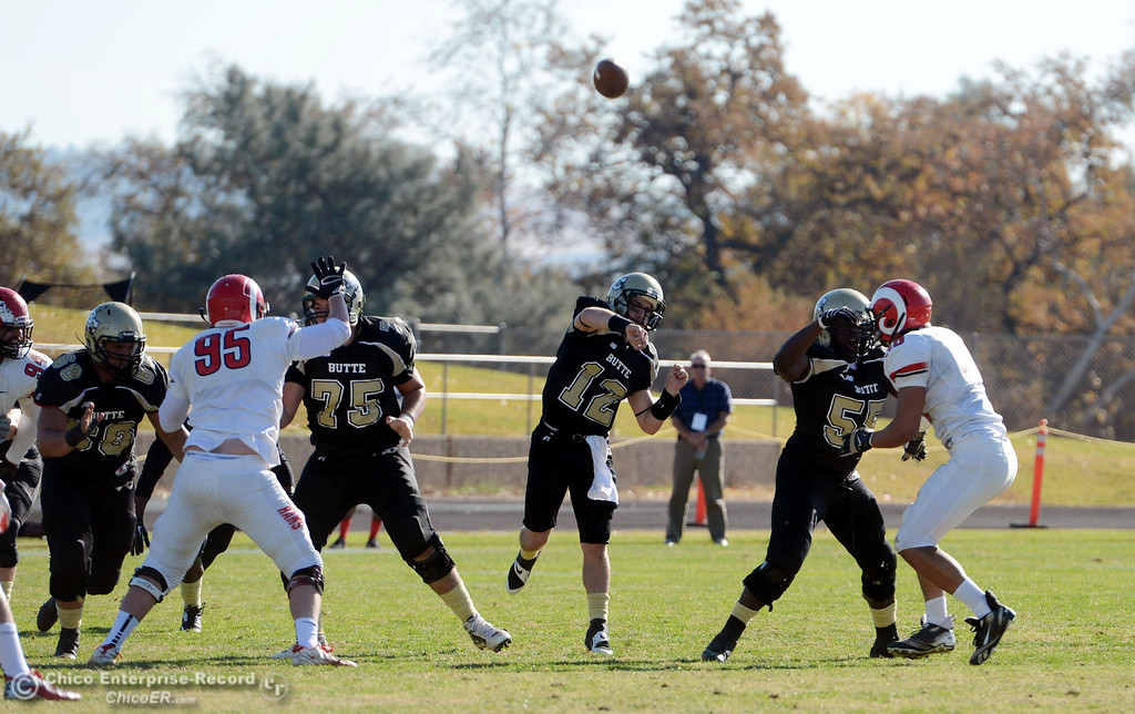 . Butte College\'s #12 Thomas Stuart throws a touchdown pass to CJ Grice against Fresno City College in the first quarter of their football game at Butte\'s Cowan Stadium Saturday, November 30, 2013 in Butte Valley, Calif.  (Jason Halley/Chico Enterprise-Record)