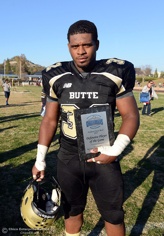 . Butte College\'s #32 Brian Anderson received the Defensive Player of the Game award against Fresno City College at the end of their football game at Butte\'s Cowan Stadium Saturday, November 30, 2013 in Butte Valley, Calif.  (Jason Halley/Chico Enterprise-Record)