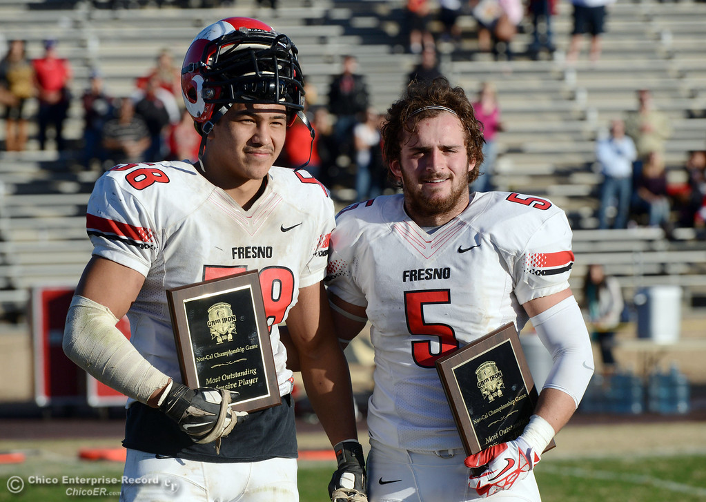 . Fresno City College\'s #58 Thomas Coronado (left) was named Nor Cal most outstanding defensive player and #5 Marcus Montero was named Nor Cal most outstanding offensive player against Butte College at the end of their football game at Butte\'s Cowan Stadium Saturday, November 30, 2013 in Butte Valley, Calif.  (Jason Halley/Chico Enterprise-Record)