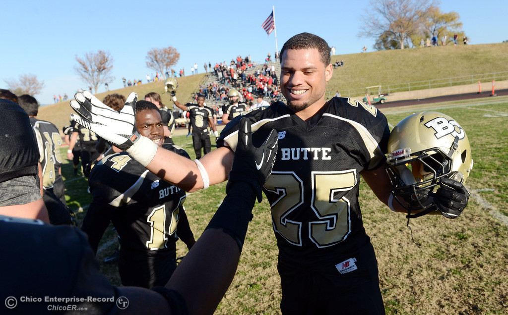 . Butte College\'s #25 De\'Aundray Gooden celebrates their win against Fresno City College at the end of their football game at Butte\'s Cowan Stadium Saturday, November 30, 2013 in Butte Valley, Calif.  (Jason Halley/Chico Enterprise-Record)