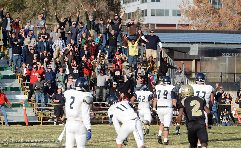 . Butte College fans reacts to London Muse touchdown off an interception against Fullerton College in the fourth quarter of their CCCAA football state championship final at Butte\'s Cowan Stadium Saturday, December 14, 2013 in Butte Valley, Calif. (Jason Halley/Chico Enterprise-Record)