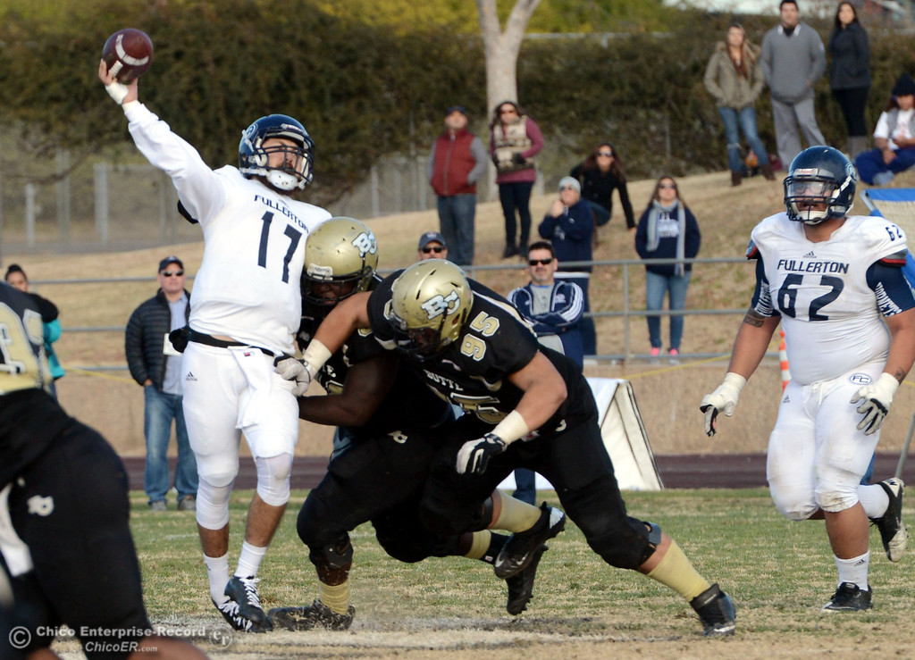 . Butte College\'s #50 Joshua Wormley (center) and #95 Mark Rosenquist (right) tackle against Fullerton College\'s 317 Jose Escobar (left) in the fourth quarter of their CCCAA football state championship final at Butte\'s Cowan Stadium Saturday, December 14, 2013 in Butte Valley, Calif. (Jason Halley/Chico Enterprise-Record)