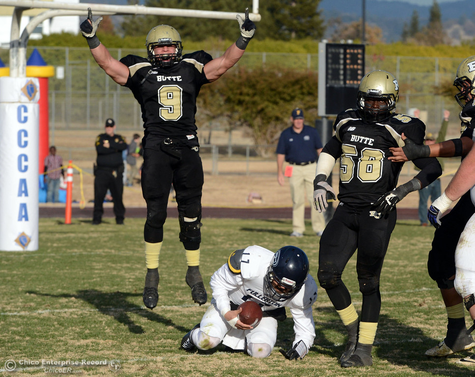 . Butte College\'s #9 Tyler Adair (left) reacts to a sack by #58 Sie Doe Jr. (right) against Fullerton College\'s #17 Jose Escobar (bottom)  in the fourth quarter of their CCCAA football state championship final at Butte\'s Cowan Stadium Saturday, December 14, 2013 in Butte Valley, Calif. (Jason Halley/Chico Enterprise-Record)