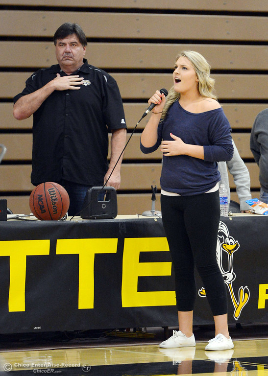 . Kim Asbury sings the National Anthem before the Butte College against San Jose City College first half of their men\'s basketball game at Butte\'s Cowan Gym Friday, February 28, 2014 in Oroville, Calif.  (Jason Halley-Chico Enterprise-Record)