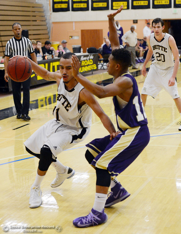 . Butte College\'s #11 Jamaal Davis (left) dribbles against San Jose City College\'s #12 Tyrone Viney (right) in the second half of their men\'s basketball game at Butte\'s Cowan Gym Friday, February 28, 2014 in Oroville, Calif.  (Jason Halley-Chico Enterprise-Record)