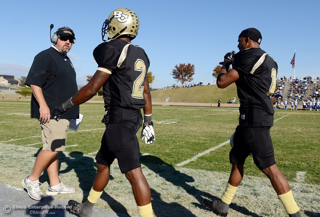 . Butte College coach Jeff Jordan (left) #2 Deonte Flemings (center) and #1 Wes McCoy (right) against College of San Mateo in the fourth quarter of their football game at Butte\'s Cowan Stadium Saturday, November 2, 2013 in Oroville, Calif.  (Jason Halley/Chico Enterprise-Record)